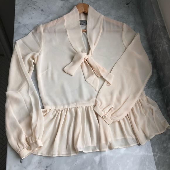 ASOS Tops - ASOS sheer cream blouse with ruffle & bow detail